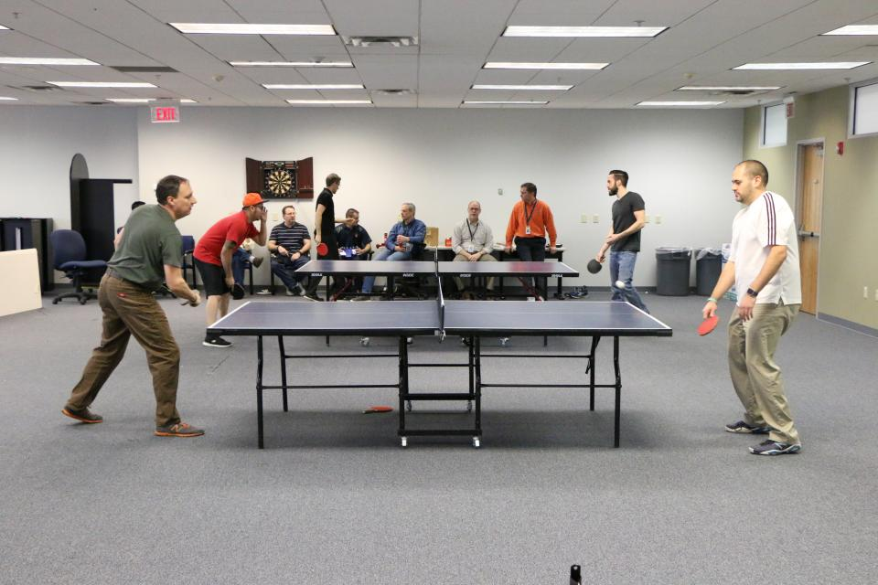 Employees get competitive at our annual table tennis tournament.