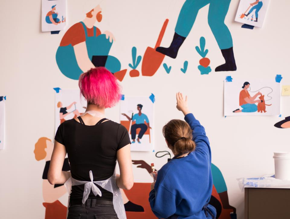 A Gusto company value is 'We are all builders.' Gusto employees were involved in every stage of the office from design work to building and finishing touches. Dozens of employees spent their inaugural week painting a 40-foot long mural in its 'all-hands' space.