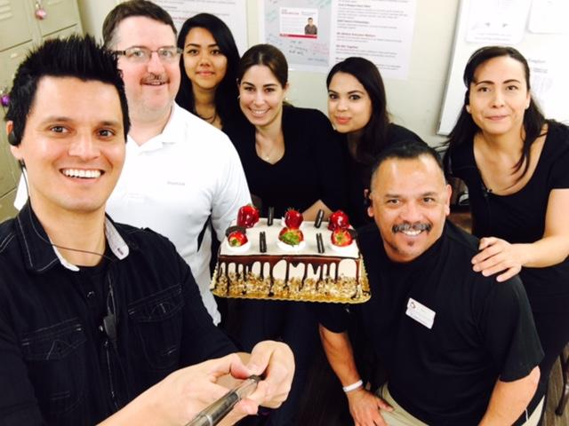"Store team #239 – Las Vegas celebrates a job well done with cake and a selfie! All stores have an ""Our Burlington"" selfie stick to take fun team photos and share on our associate portal."