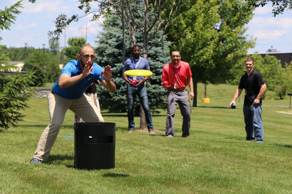 At our annual backyard picnic, employees take a break from work to enjoy a cookout and play games together.