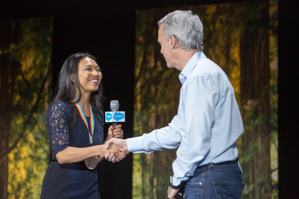 Salesforce Founder Parker Harris honors a Salesforce employee at TrailheaDX, a Salesforce developer conference.