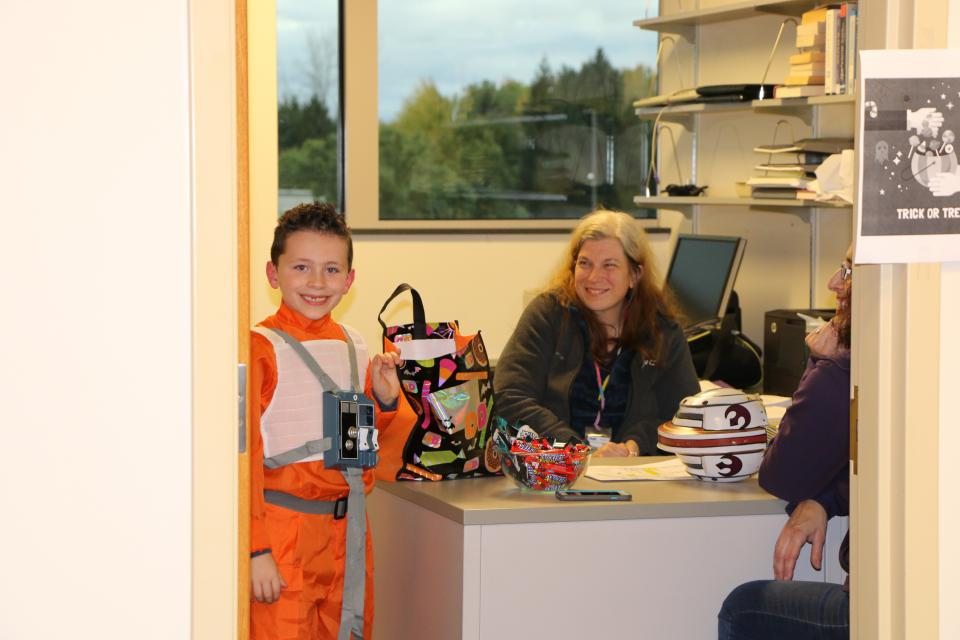 A rebel pilot visits SRC to trick or treat at our office.