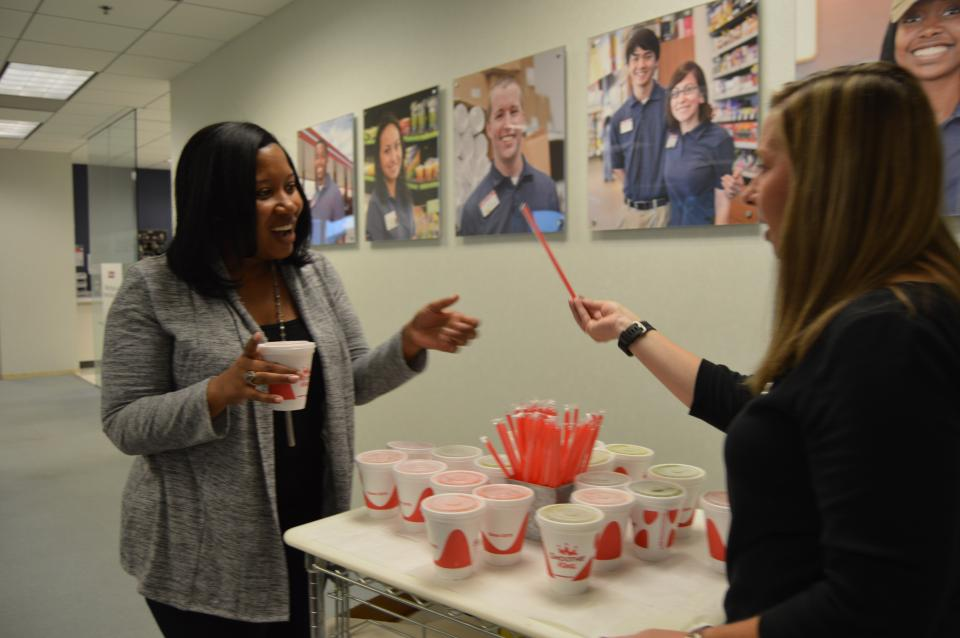 VP of Total Rewards, Whitney Woodward, hands out a special treat to SSC Team Members.