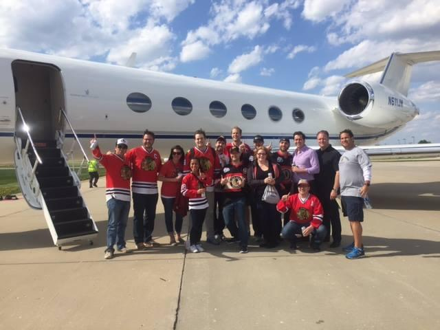 CEO Ryan Daube surprised 15 AFN team members with a trip to Blackhawks vs. Blues Game 7 in St. Louis.