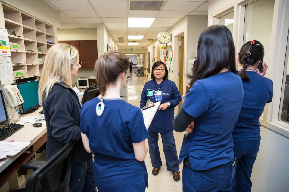 Nurses attend daily huddle meeting