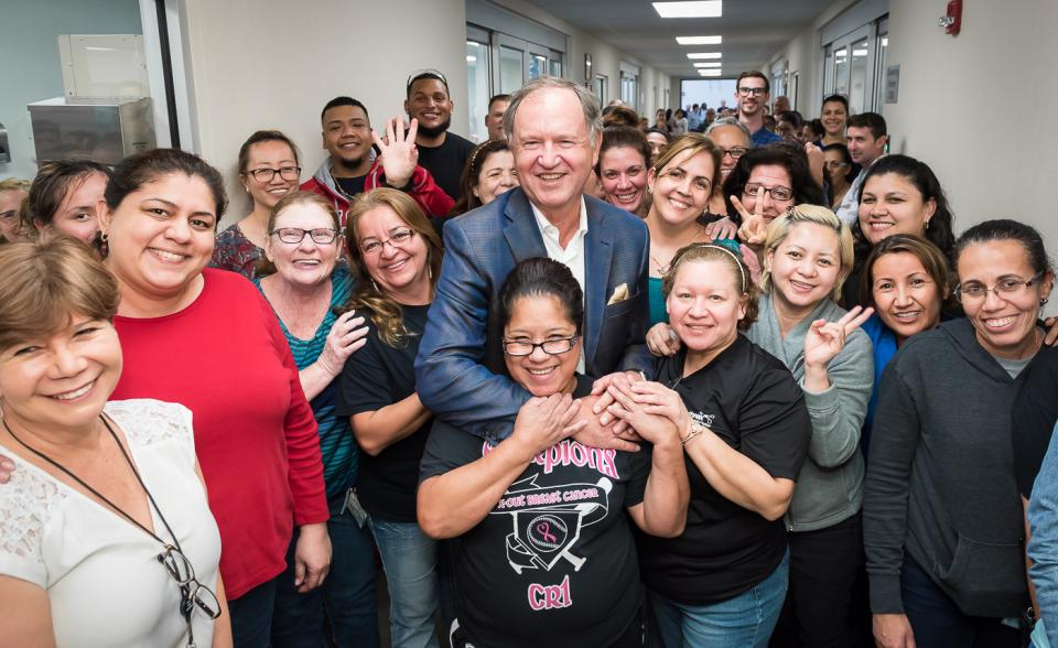 Manufacturing employees greet President and Founder Reinhold Schmieding during his visit to Arthrex Manufacturing East.