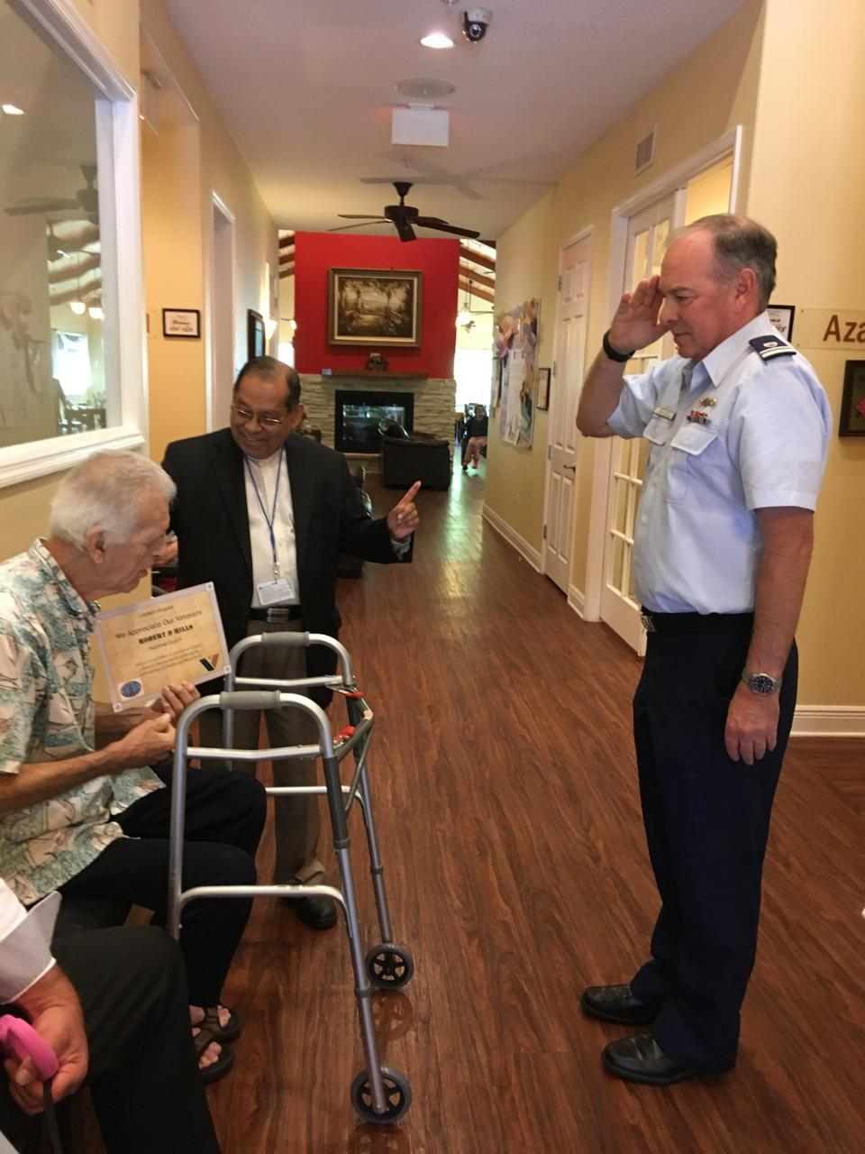lifepath hospice chaplain mathai abraham performs we honor veterans pinning ceremony for a veteran