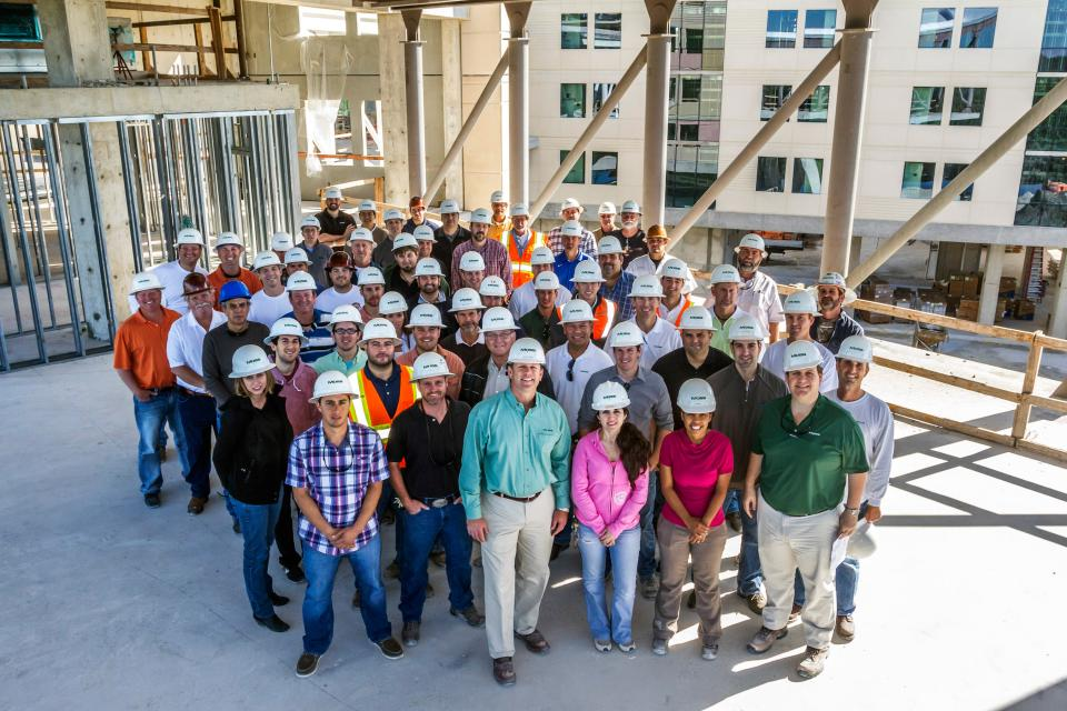 Moss staff gather for a group photo at an informational site walk on the FIU Parkview Hall project job site.