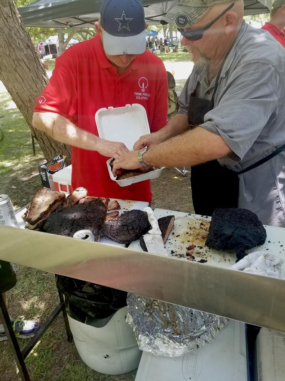 Think Power Team barbecuing at the Lineman's Rodeo
