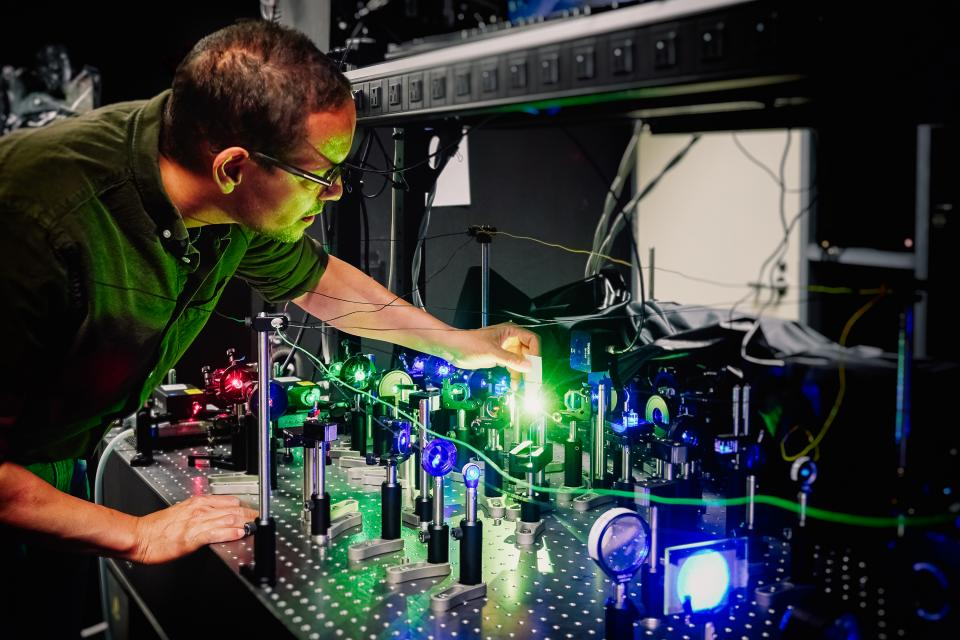 NVIDIA researcher testing lasers in the company's optics lab.