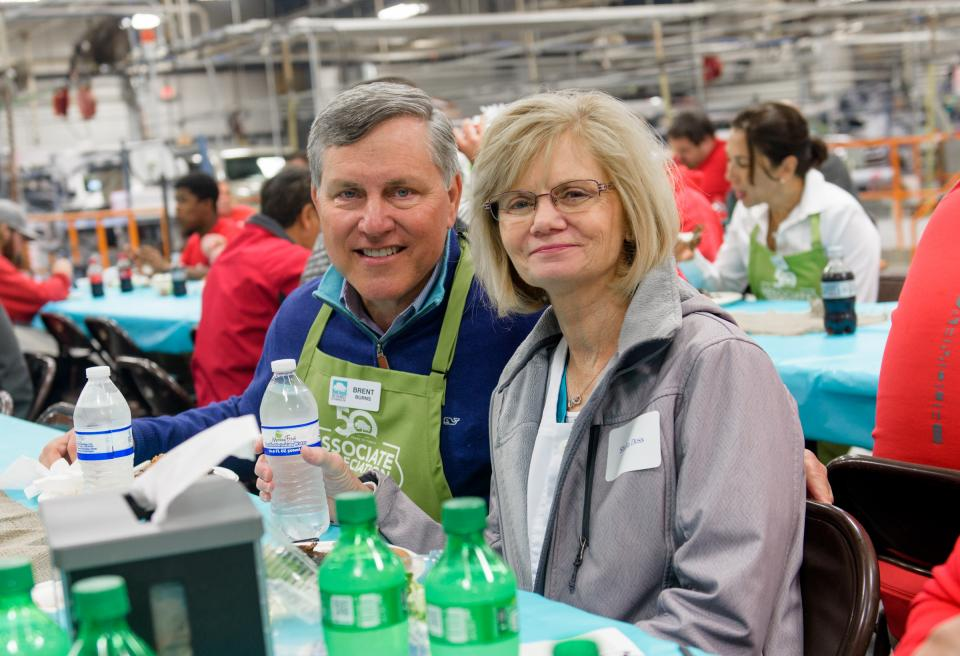 JM Family's President and CEO Brent Burns shares a lunch with a fellow associate during an appreciation lunch. The annual event is one of the many ways senior leaders share their gratitude for associates' hard work and dedication.