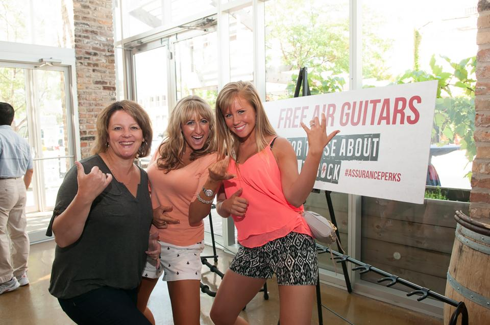Laurie Groves, Allie Iacovelli and Christina Diltz (left to right) rock out during Employee Appreciation Day.