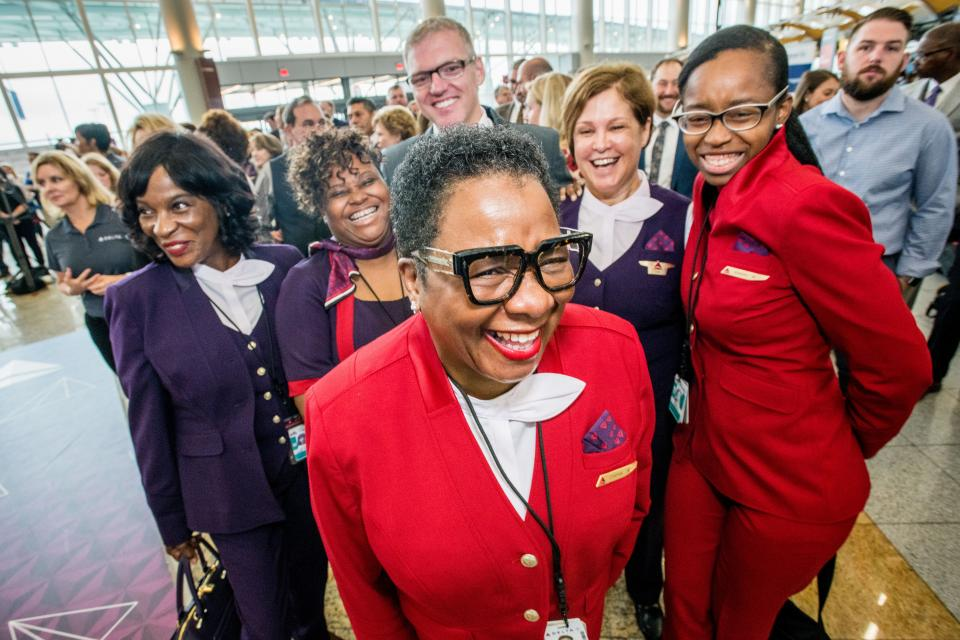 Delta employees celebrate at the Atlanta fashion show, previewing the company's new uniforms designed by Zac Posen.