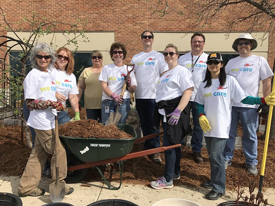 Earth Days of Caring are great for team building, and mulching. This group of employees in Madison, Wis., did spring cleanup at the University of Wisconsin-Extension Teaching Gardens.