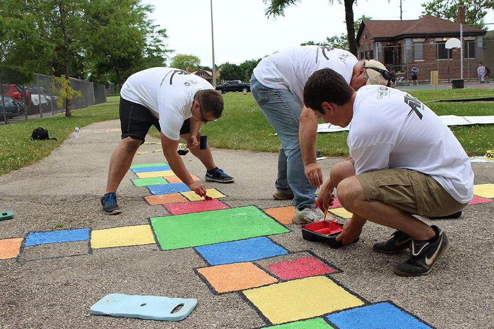 Employee volunteers had fun installing a United Way Born Learning Trail at a park in Milwaukee, Wis.