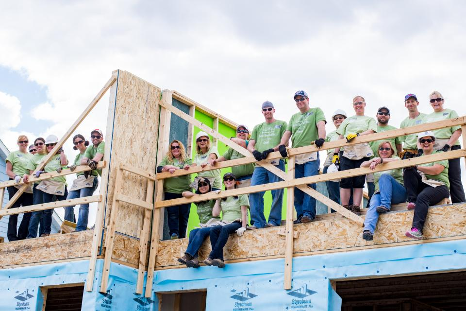Employee volunteers helped put up second-story walls in a local family's future home with Habitat for Humanity's Women Build project.