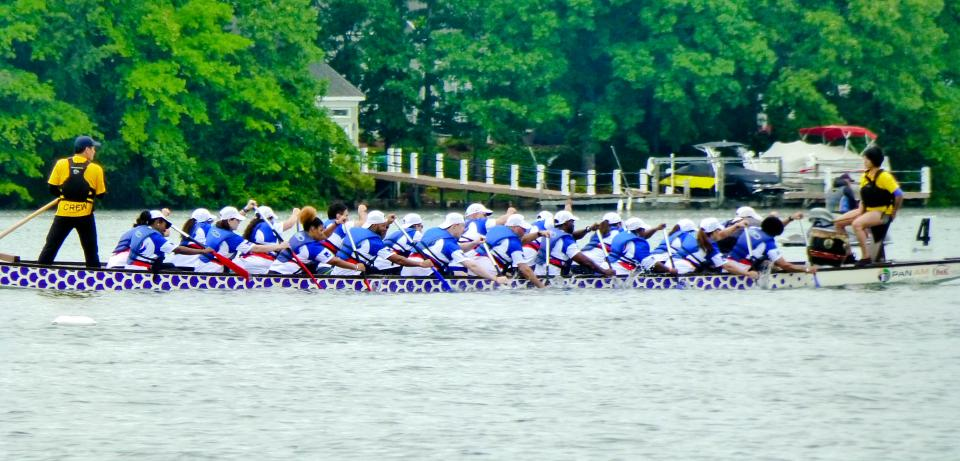 AXA's Dragon Boat team races towards the finish line at the Charlotte Dragon Boat Festival.