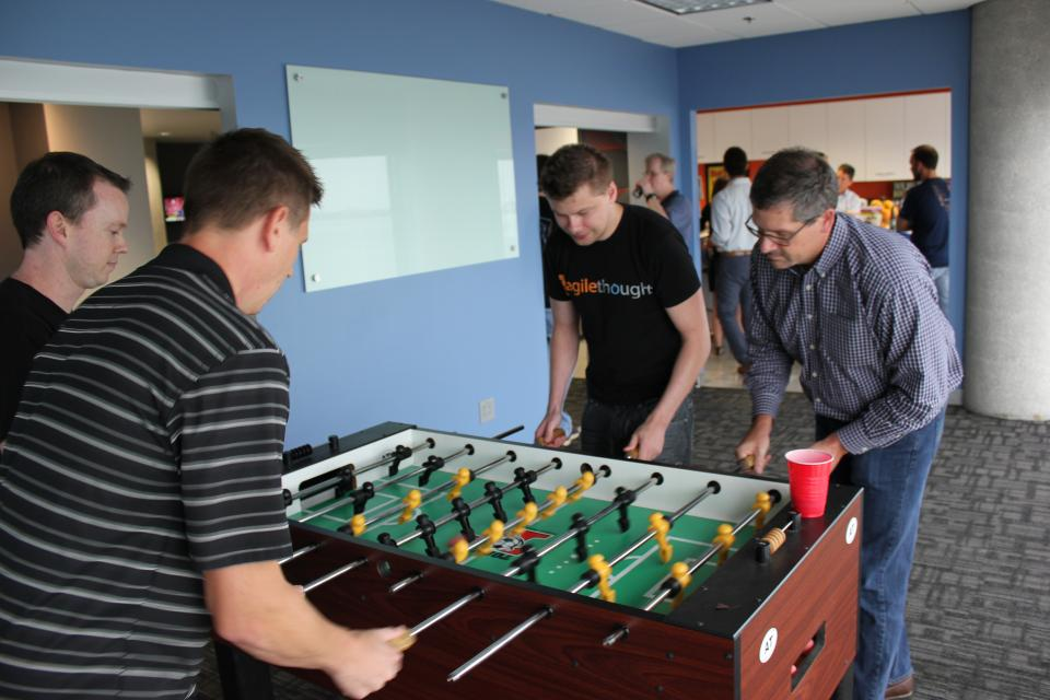 Foosball tournament at AgileThought office.