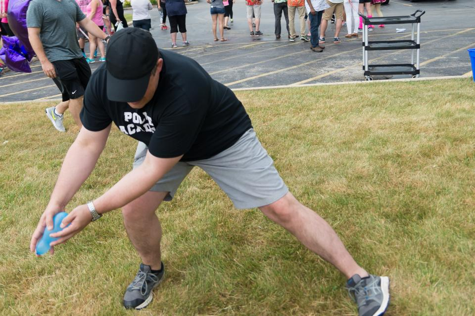 Tony Alberico makes a great save during water balloon toss at the 2017 Assurance Olympics.