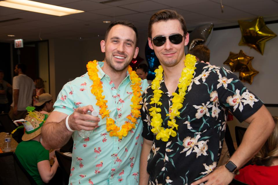 Tony Colucci (left) and Tim Orlowski (right) celebrate a successful Assurance Olympics for Team Honolulu.