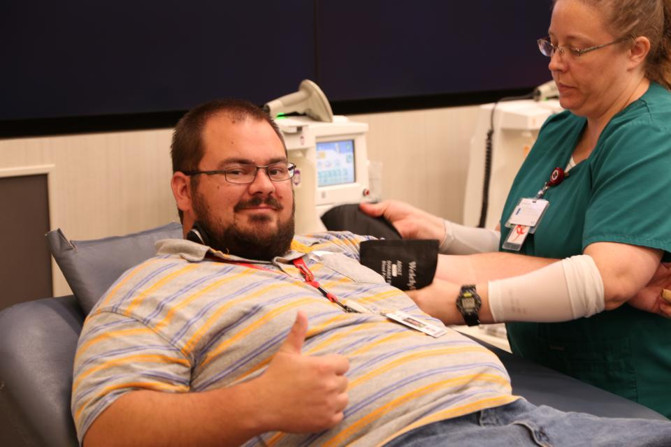 A Colleague donates blood during an on-site blood drive.