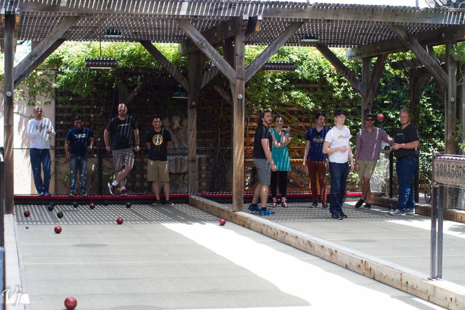 Study.com employees enjoy an afternoon of bocce ball.