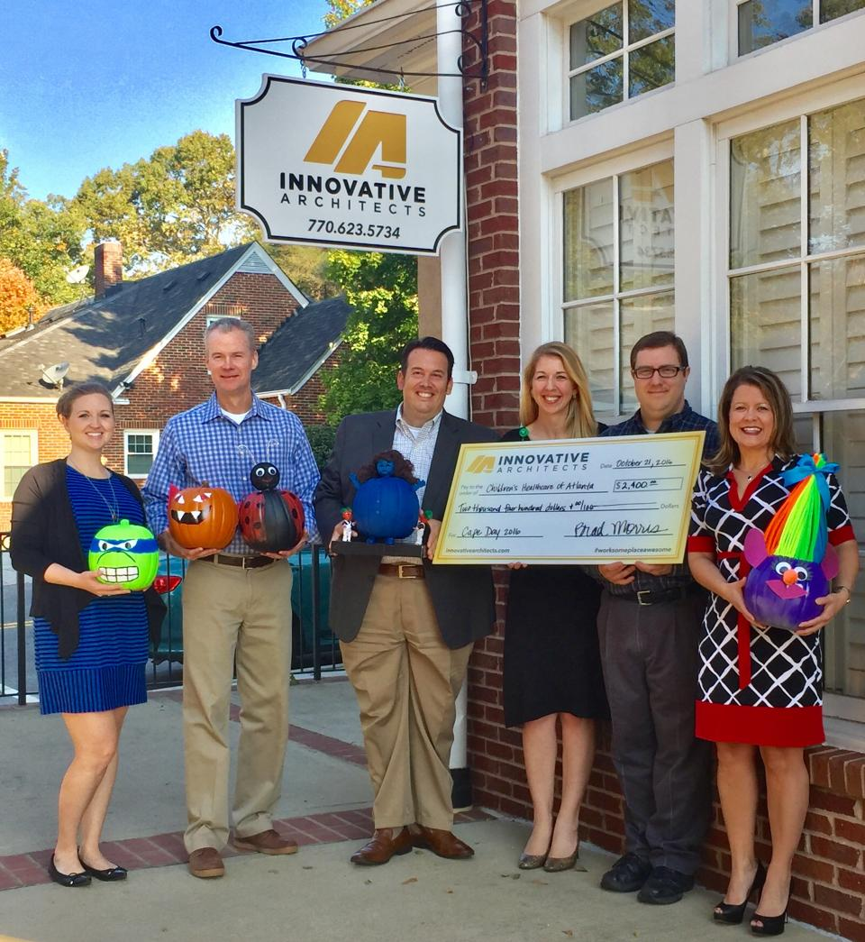 Presenting our Cape Day donation to the Children's Healthcare of Atlanta!