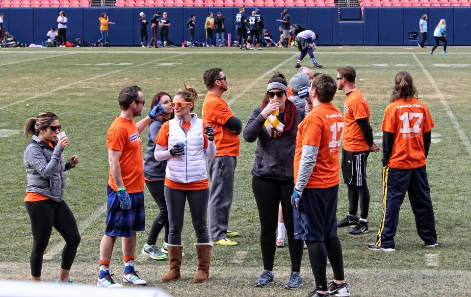 BluSky employees play touch football at Mile High Stadium in Denver Colorado to raise money for Crohn's Disease.