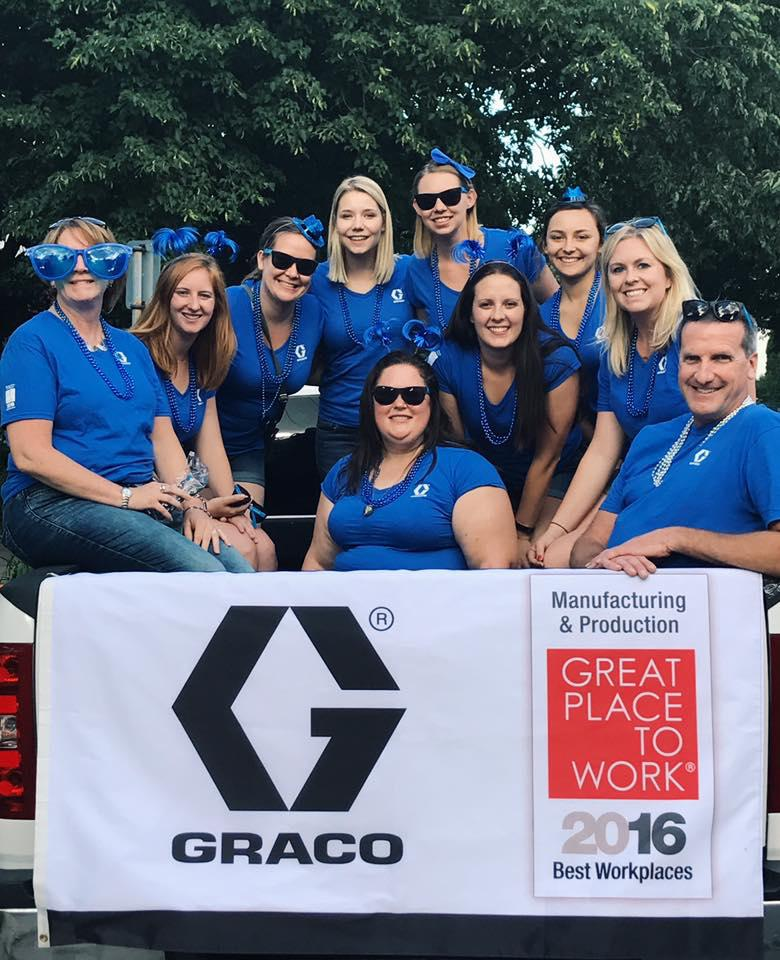 Graco employees representing the company at a local parade