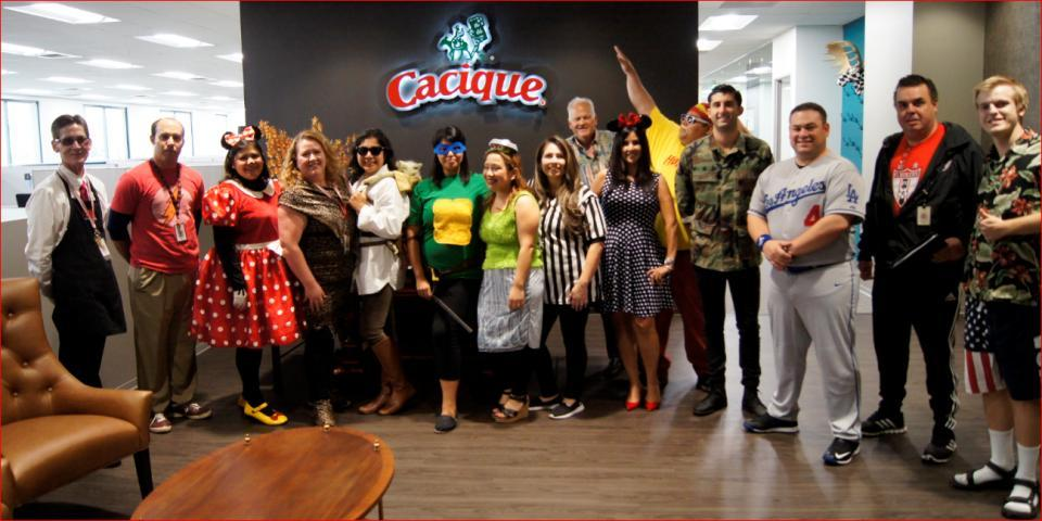 cacique team members in the halloween spirit