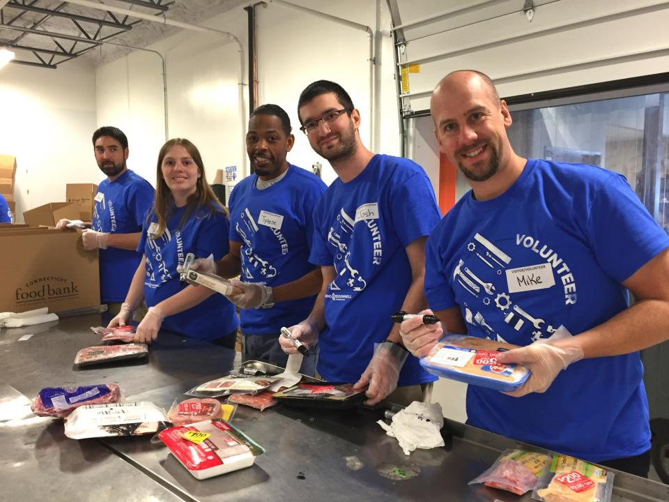 Employee-owners in Connecticut volunteered at a local food bank as part of our Charity of Choice campaign.