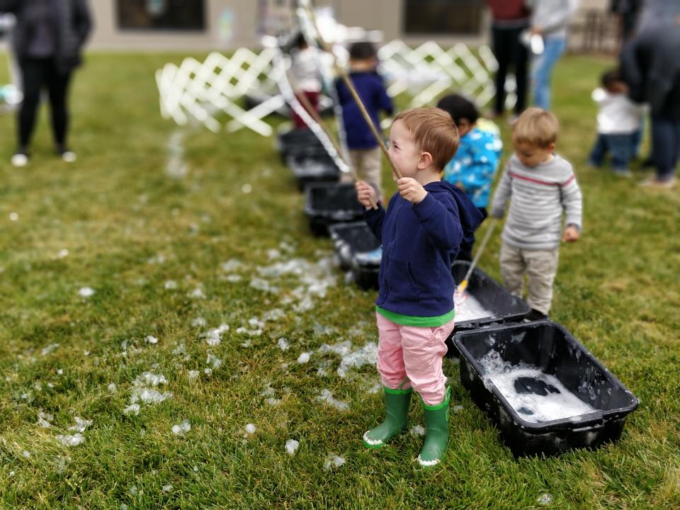 Children of Second Genome employees enjoy bubbles at Bring Your Babies to Work Day