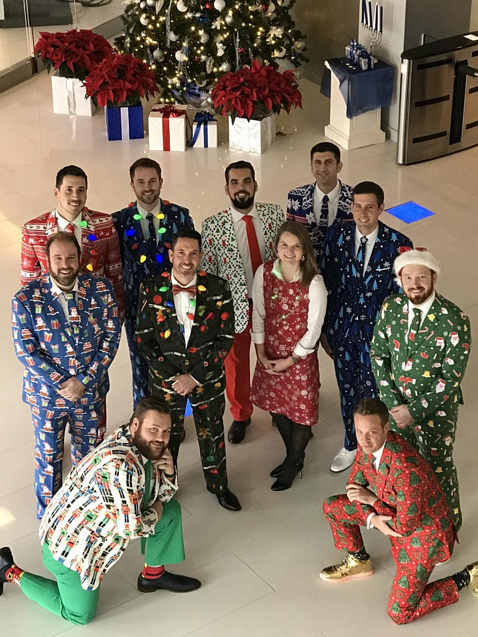 Our colleagues show their holiday spirit by wearing festive outfits, complete with holiday prints and lights