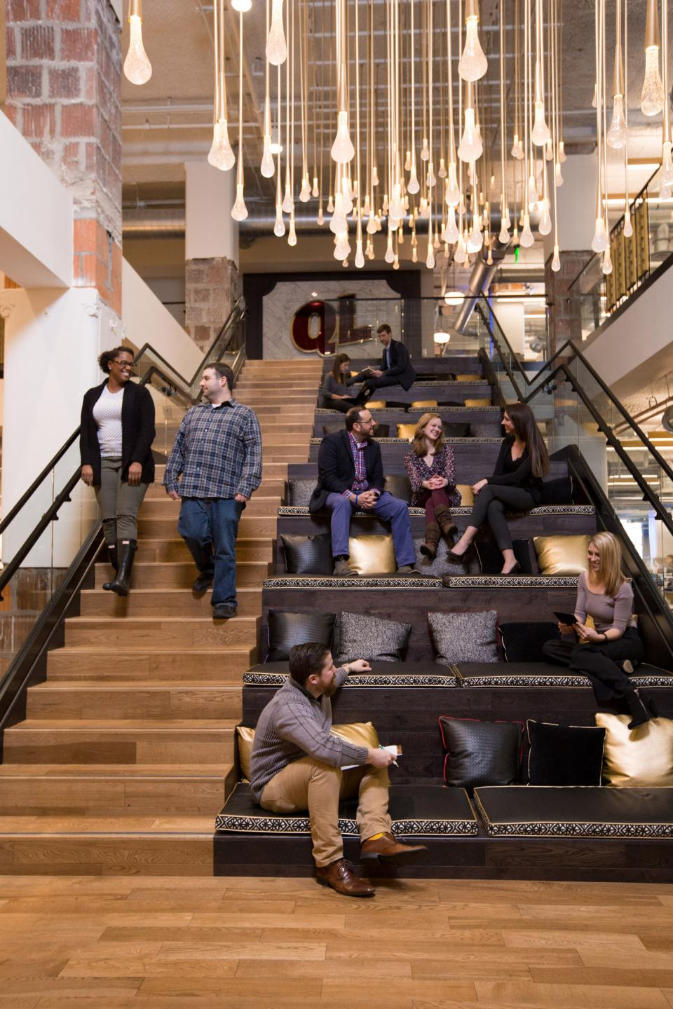 Team members meet on the stairs of Quicken Loans' newly renovated Cleveland office.