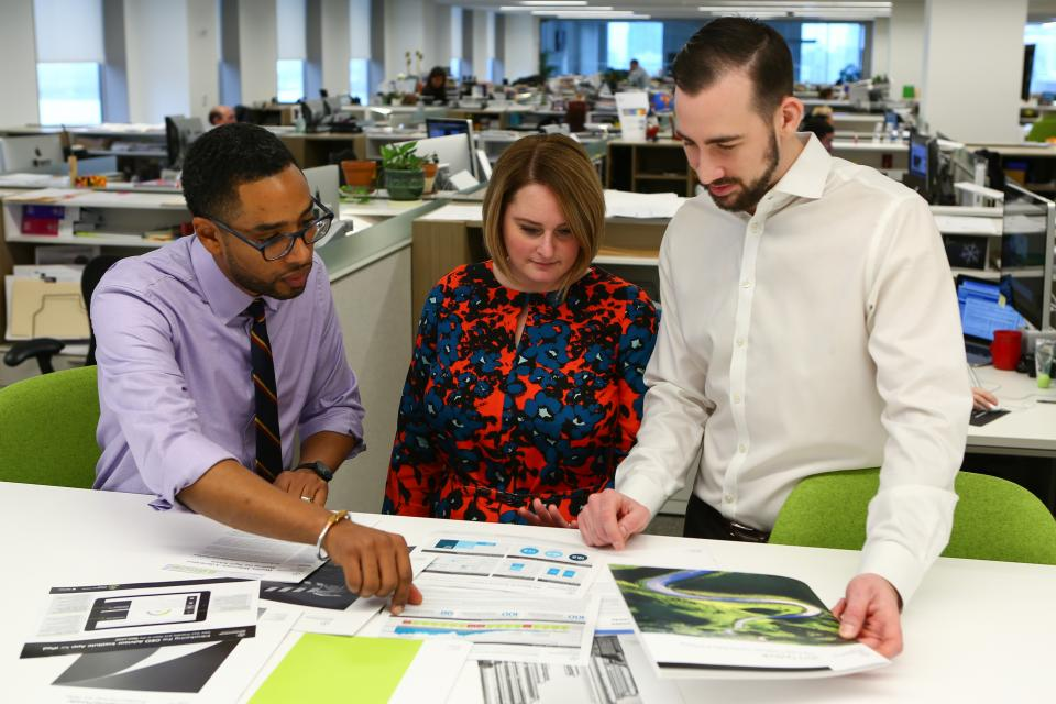 Employees in our New York office collaborate on a project.