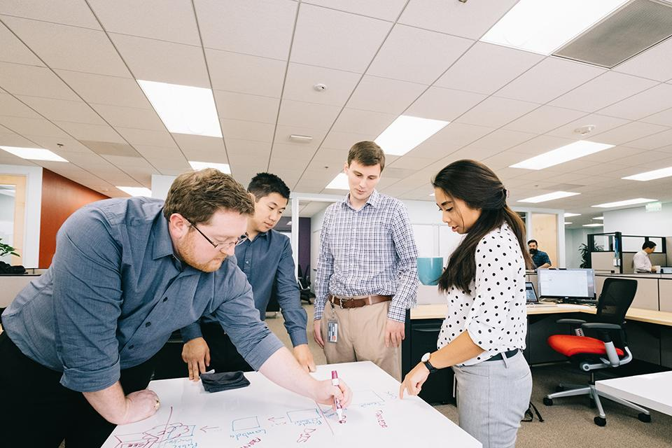 Fins collaborating around a white board table in our Los Angeles office!