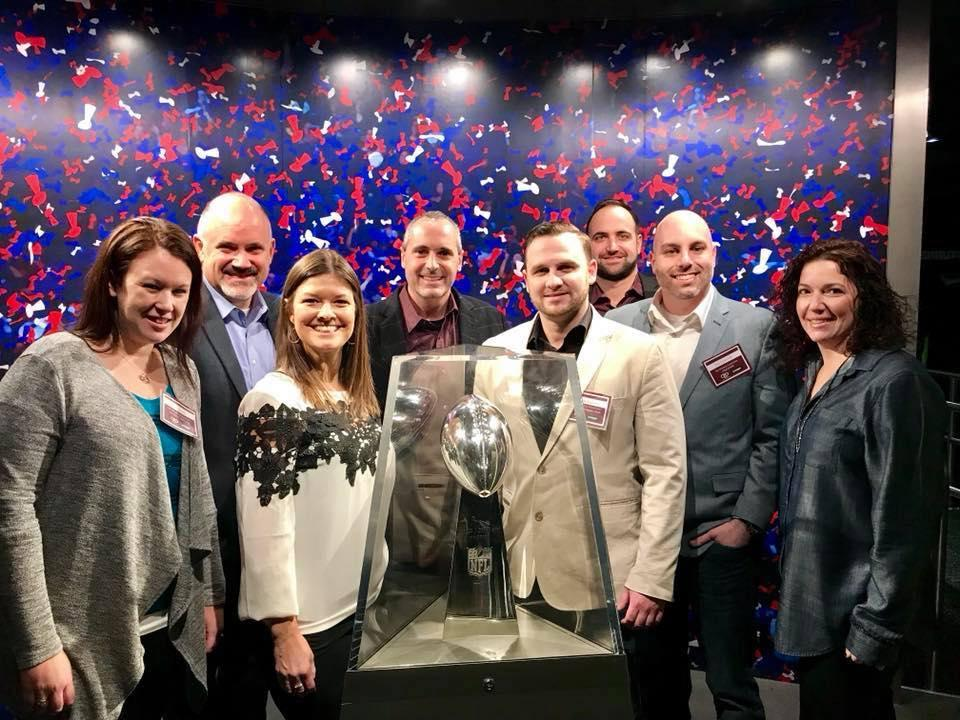 Members of the TWE Leadership Team at the NFL Experience in NYC accepting an award for our Corporate Culture