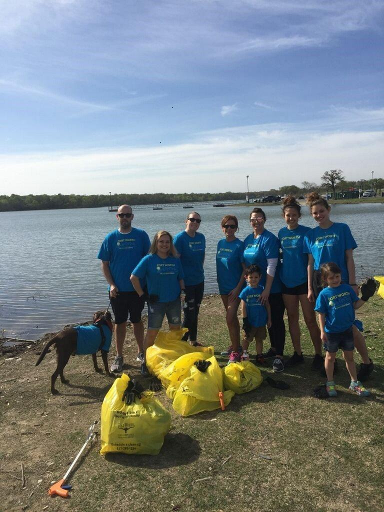 Dallas Fort Worth Volunteer with family clean-up