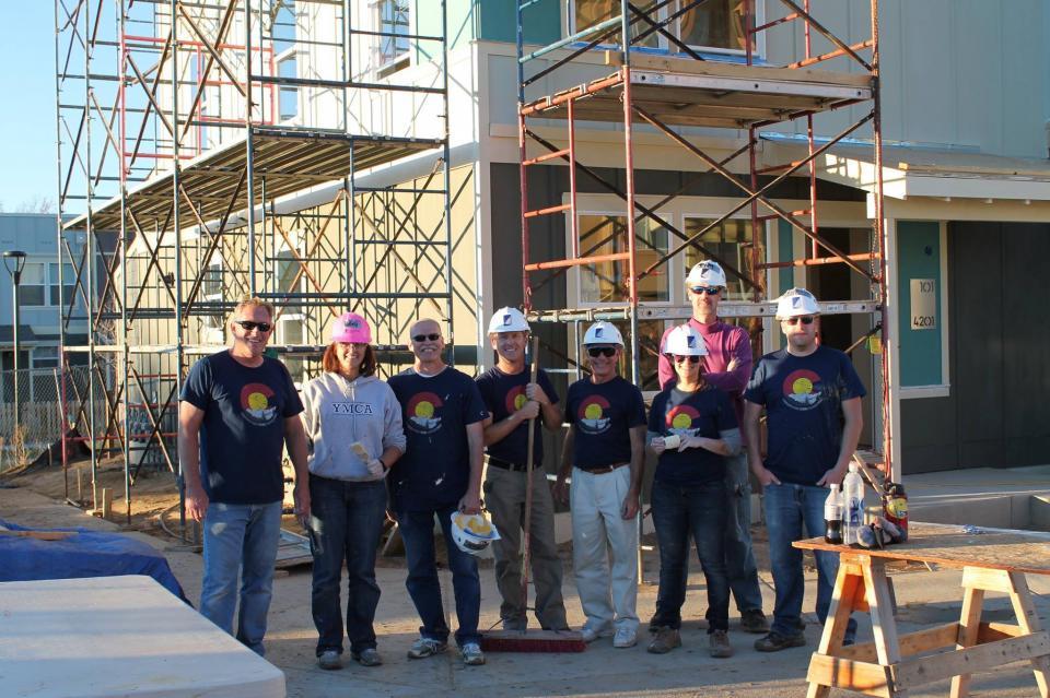 Employees in Denver lending a helping hand