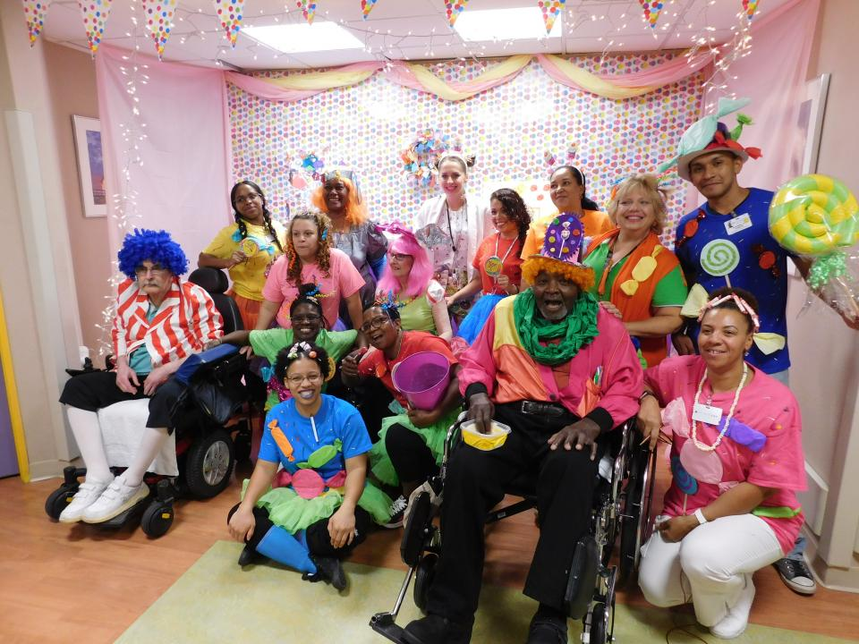 Memory Care unit staff and residents go all out in creating a Candy Land theme for the annual Gurwin Masquerade, winning them First Prize!