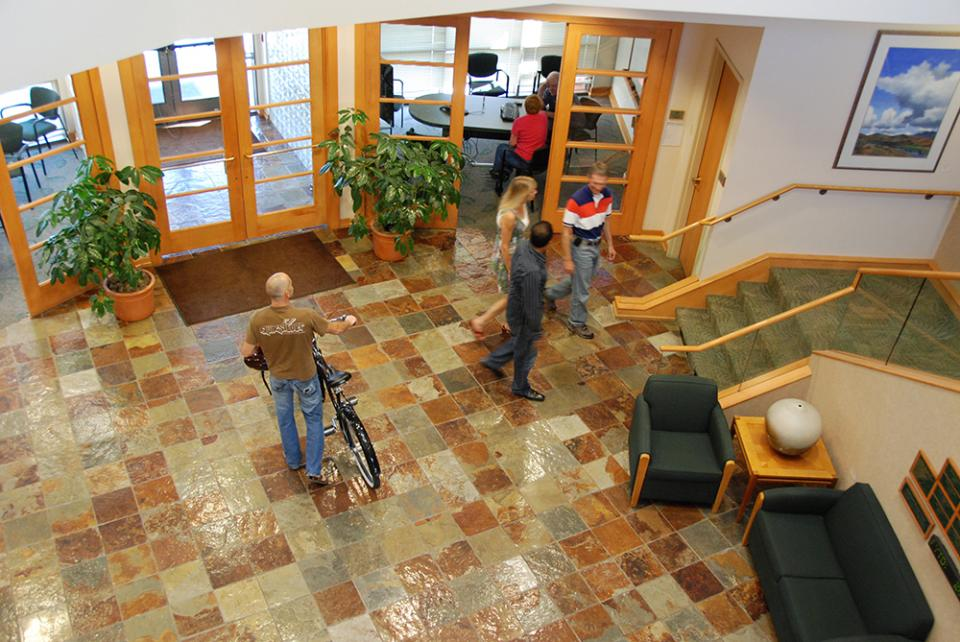 Employees pass through the large, open lobby of the main building on the Healthwise Boise campus.
