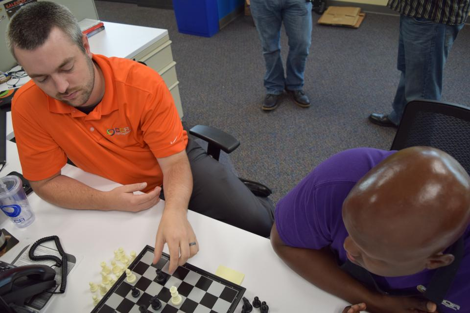 A friendly game of chess is a common activity around the office.