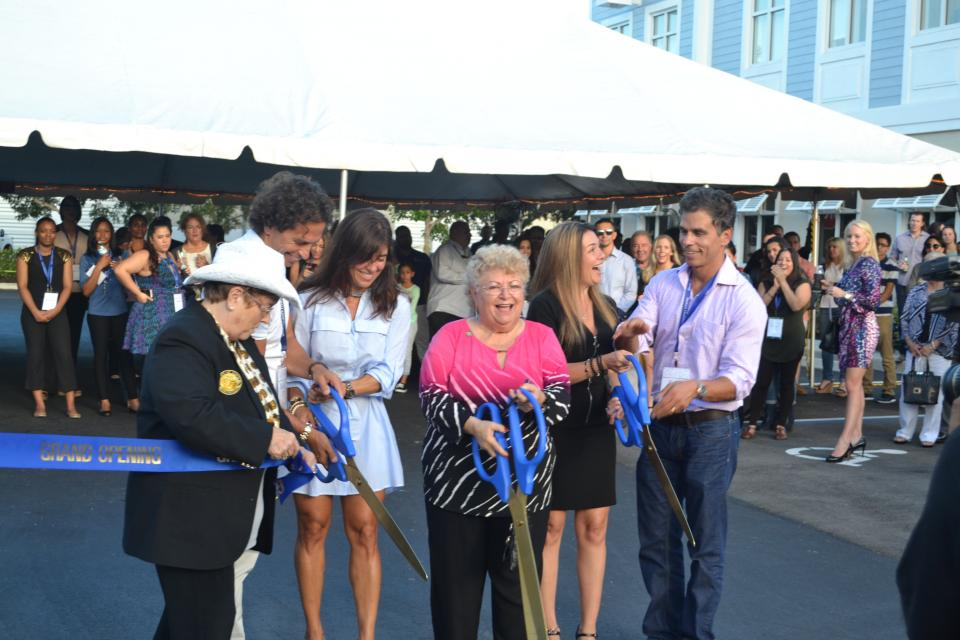Mayor Judy Paul cuts the ribbon with BHG co-founders and brothers Eric and Bob Castro at BHG's corporate HQ in Davie, Florida.