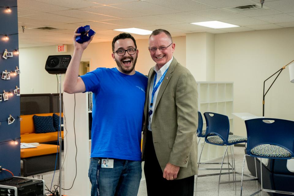 ERIE Regional Vice President Joe Vahey, right, celebrates with IT Apprentice Josh Sitter, a member of one of the winning teams at 2017 hackerie. The team explored service opportunities related to the internet of things and smart home technology.