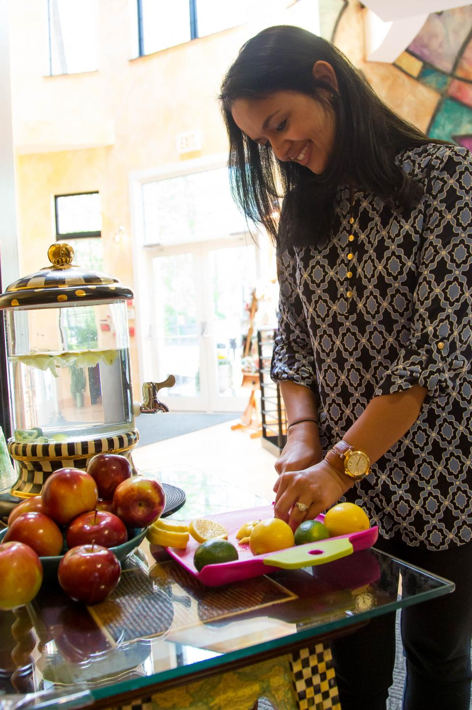 "Replacing the candy dish with fresh fruit, and the traditional ""water cooler"" with a healthy option—with rotating fresh vegetables and fruit!"