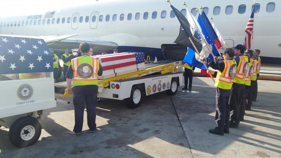 The Delta Honor Guard, a group of employee volunteers, pays tribute to a fallen Marine, being transported to his final resting place.