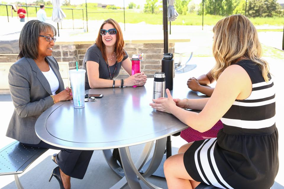 Employees in our Denver office hold a meeting using our outdoor facilities.