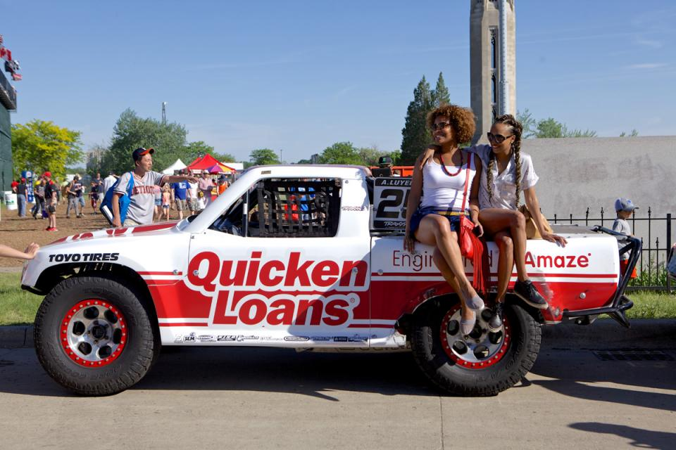 Quicken Loans team members pose on the company-sponsored Super Stadium Truck.