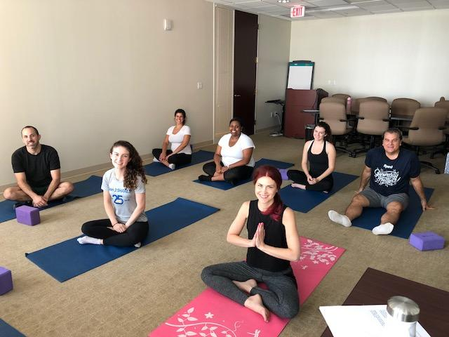 Employees at Ryan's Detroit office enjoy lunch-time yoga.