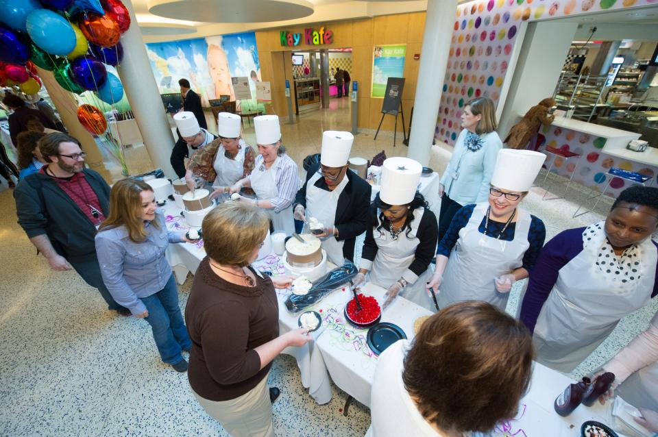 Employee volunteers serving heaps of delicious ice cream in celebration of Doctor's Day